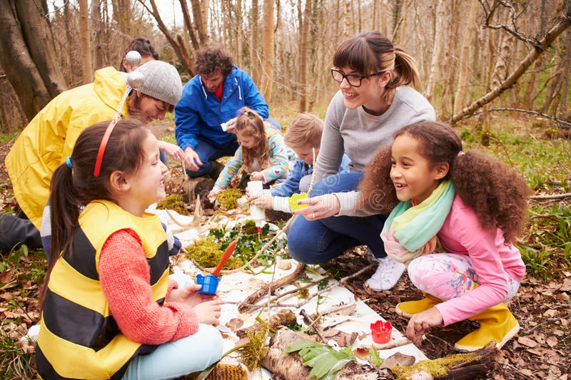 Group Looking For Minibeasts At Activity Centre stock photography