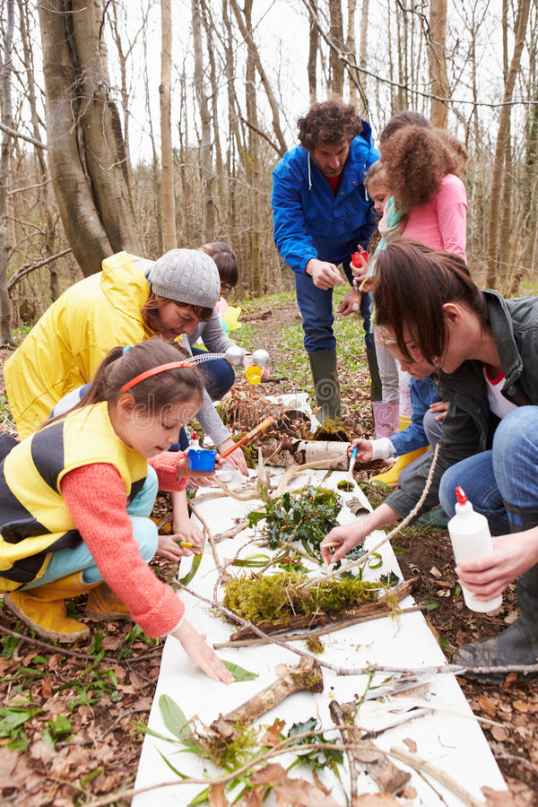 Download Group Looking For Minibeasts At Activity Centre Stock Photo - Image of bark, insect: 59780082