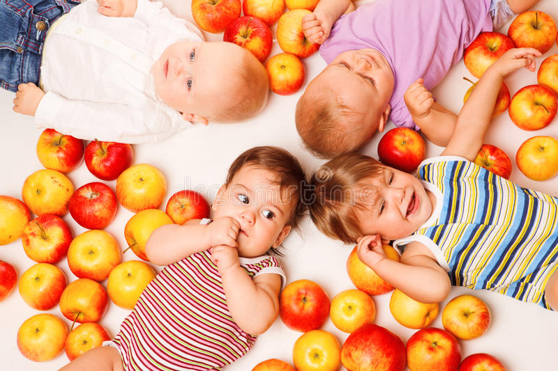 Download Group lying in apples stock photo. Image of baby, siblings - 21639936