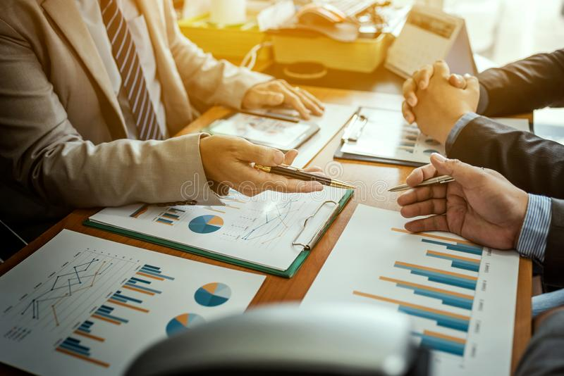 Group of male entrepreneurs discussing management project during working together and analyzing accounting trade and experience in royalty free stock image