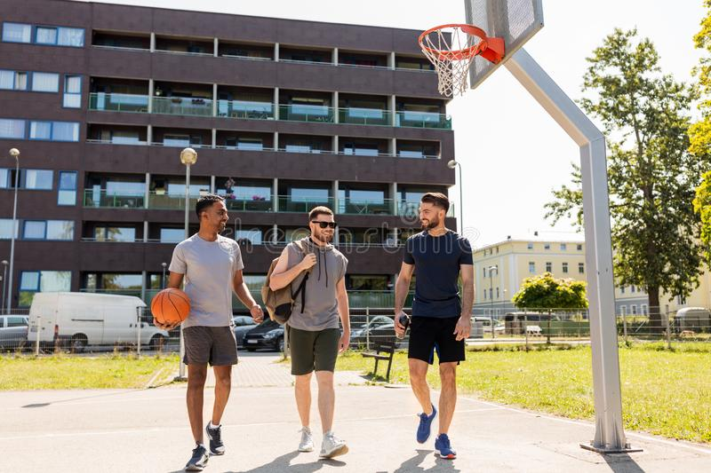Group of male friends going to play basketball royalty free stock photo