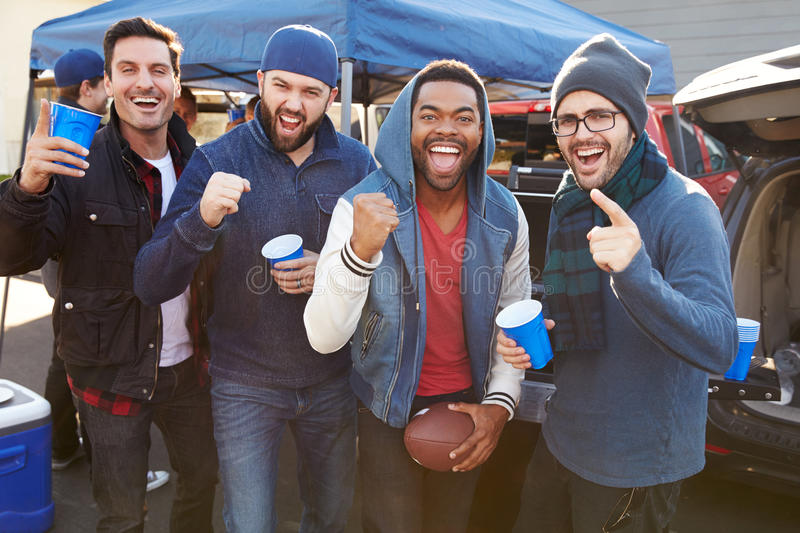 Group Of Male Sports Fans Tailgating In Stadium Car Park stock image