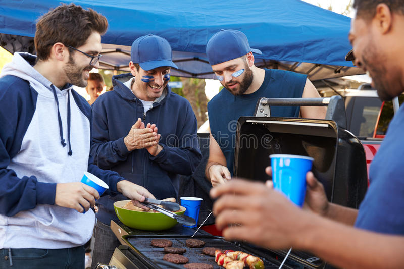 Group Of Male Sports Fans Tailgating In Stadium Car Park stock photos