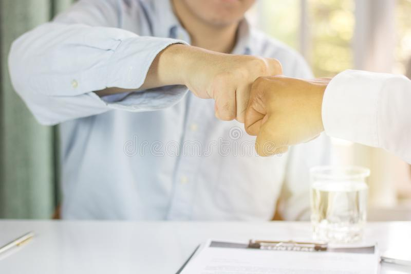 group of man punch in office, teamwork royalty free stock photo