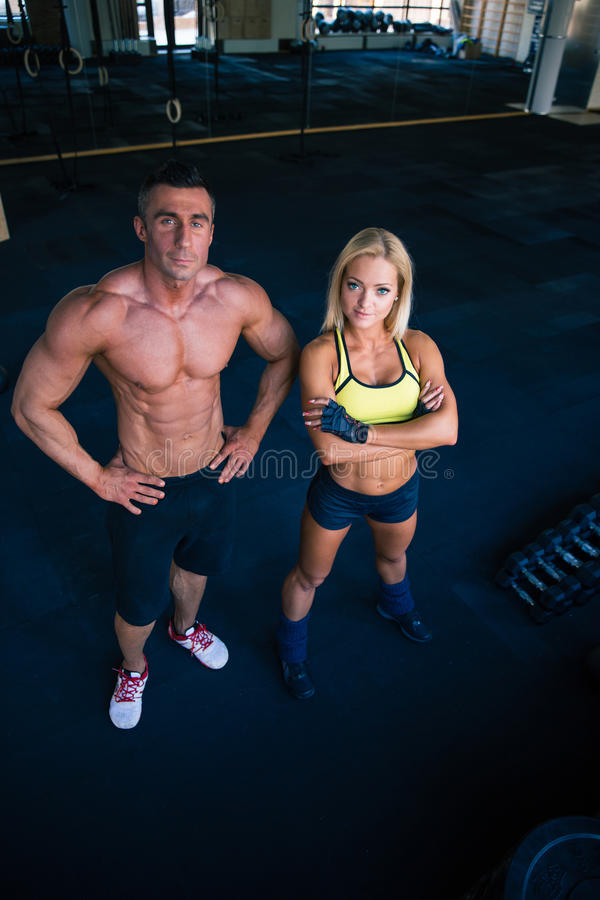Group of a man and woman in crossfit gym royalty free stock photography