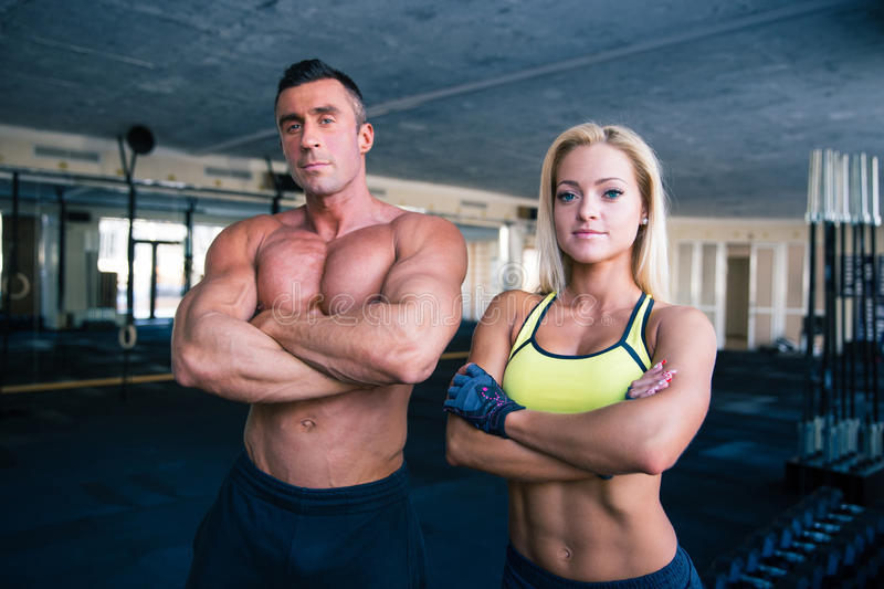 Group of a man and woman in crossfit gym stock photography