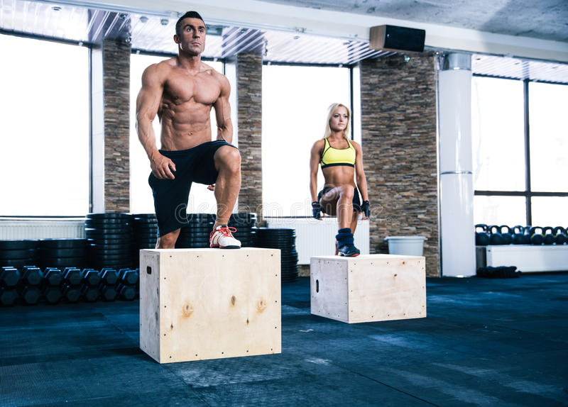 Group of man and woman working out with fit box stock photography
