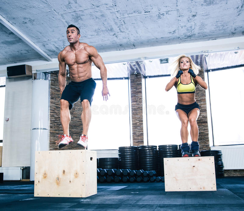 Group of man and woman working out with fit box royalty free stock photos