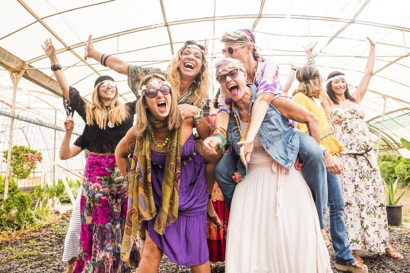 Group with many girls caucasian beautiful models have fun together celebrating with colorful dresses and friendship all together. stock photos
