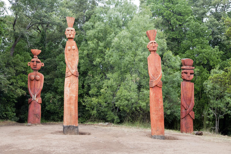 Group of Mapuchean totems at a park in Temuco. stock photography