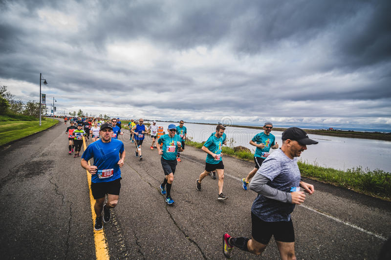 Group of Marathoners just after the Starting Line. CARLETON, CANADA - June 4, 2017. During the 5th Marathon of Carleton in Quebec, Canada. Group of Marathoners stock photos
