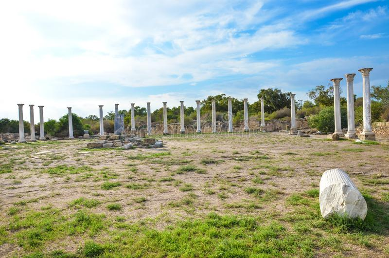 Group of marble Corinthian columns belonging to the complex of Salamis city ruins in Turkish Northern Cyprus. Taken on a beautiful day with light clouds above royalty free stock image