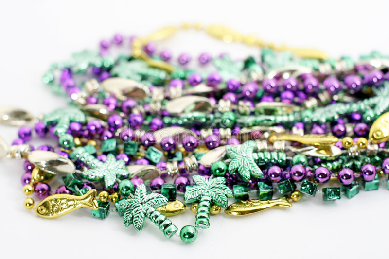 Group of mardi gras beads. Group of colorful Mardi Gras beads on white background royalty free stock photo