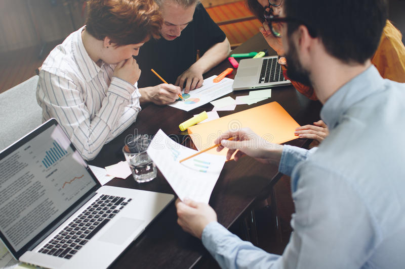 Group of marketers is thinking of a new development plan. Young royalty free stock photo