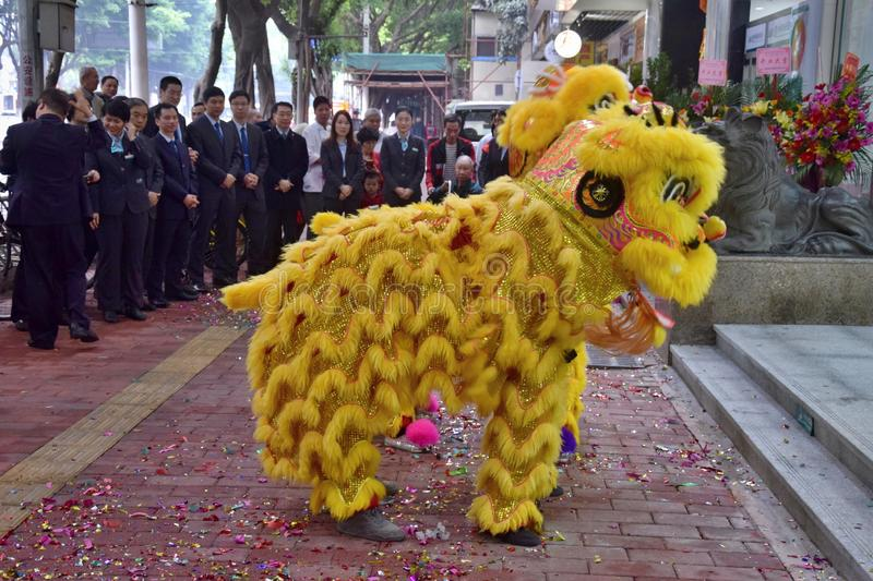 CANTON, CHINA – CIRCA FEBRUARY 2019: Group of martial art artists give a performance of Lion Dance. Group of martial art artists give a performance of royalty free stock images