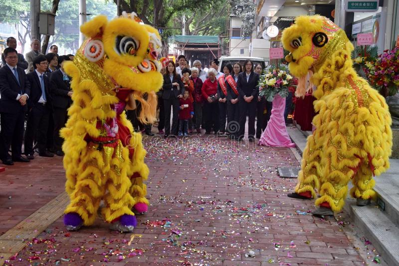 CANTON, CHINA – CIRCA FEBRUARY 2019: Group of martial art artists give a performance of Lion Dance. Group of martial art artists give a performance of stock photos