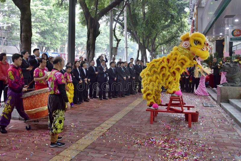 CANTON, CHINA – CIRCA FEBRUARY 2019: Group of martial art artists give a performance of Lion Dance. Group of martial art artists give a performance of royalty free stock image
