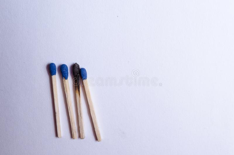 Group of 4 matches and a burnt match royalty free stock photos