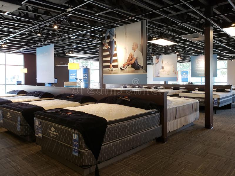 Group mattress for sale at Sleep Experts store. Nice mattress on bed for sale at Sleep Experts store, TX USA stock photos