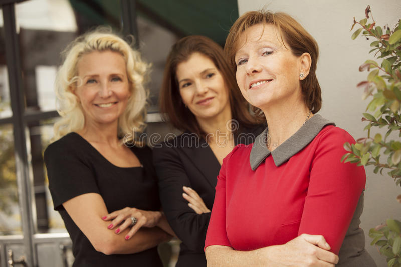 Group of mature business women. Happy group of mature business women royalty free stock photography