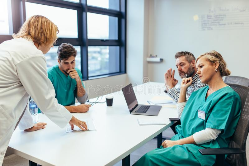 Group of medical professionals brainstorming in meeting stock photos