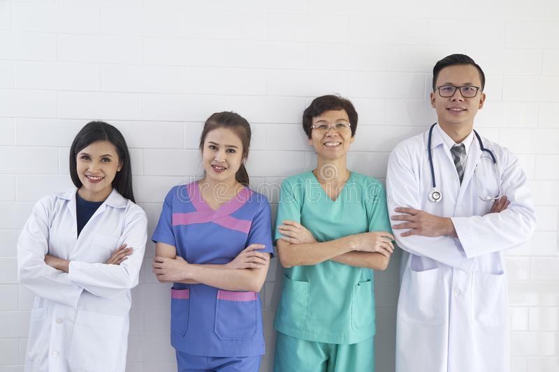 Medical workers on wall background stock images