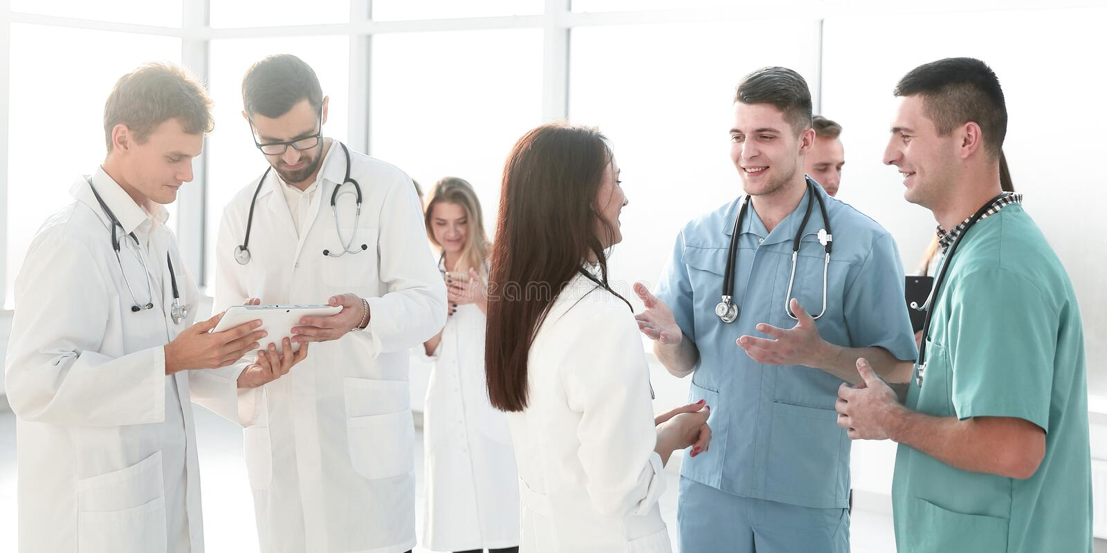 Group of medical staff discussing business documents stock photos