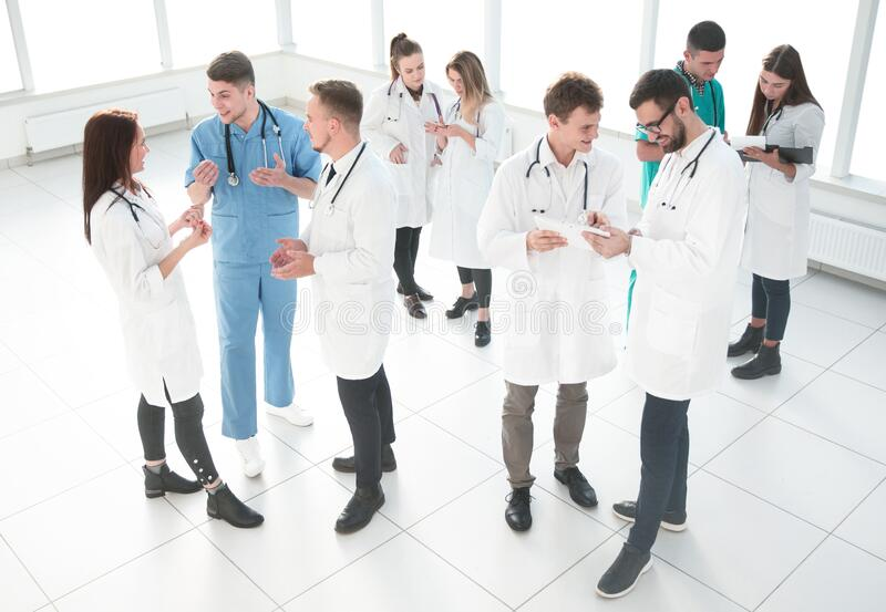 Group of medical staff discussing business documents royalty free stock image