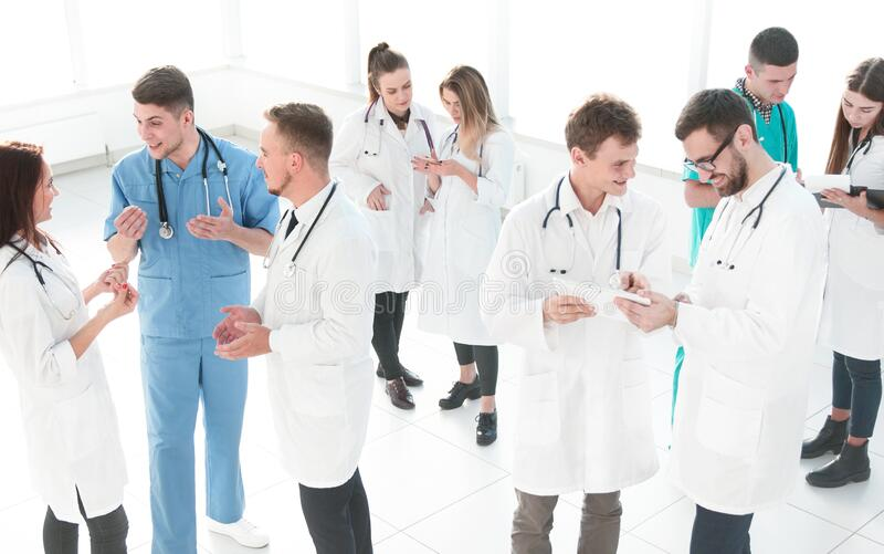 Group of medical staff discussing business documents stock photo