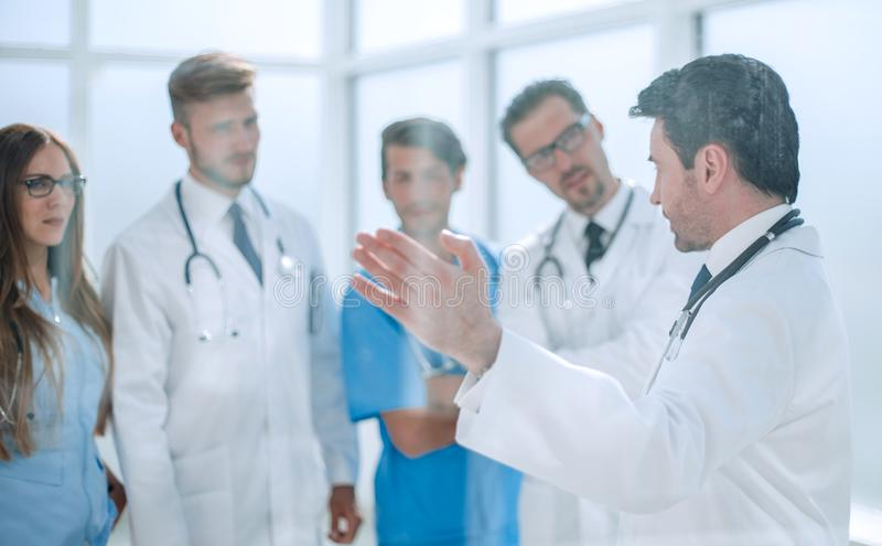 Group of medical staff is discussing in the corridor of the clinic royalty free stock photography