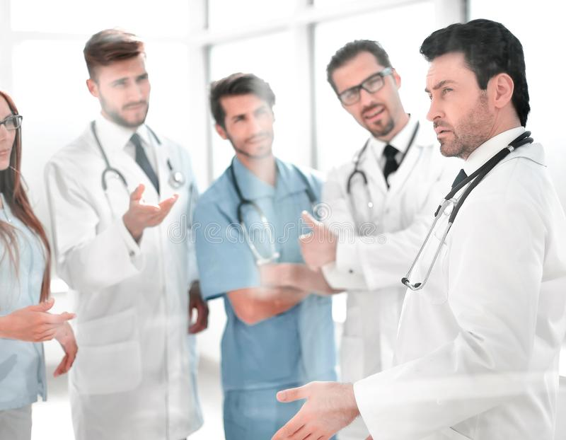 Group of medical staff is discussing in the corridor of the clinic royalty free stock photo
