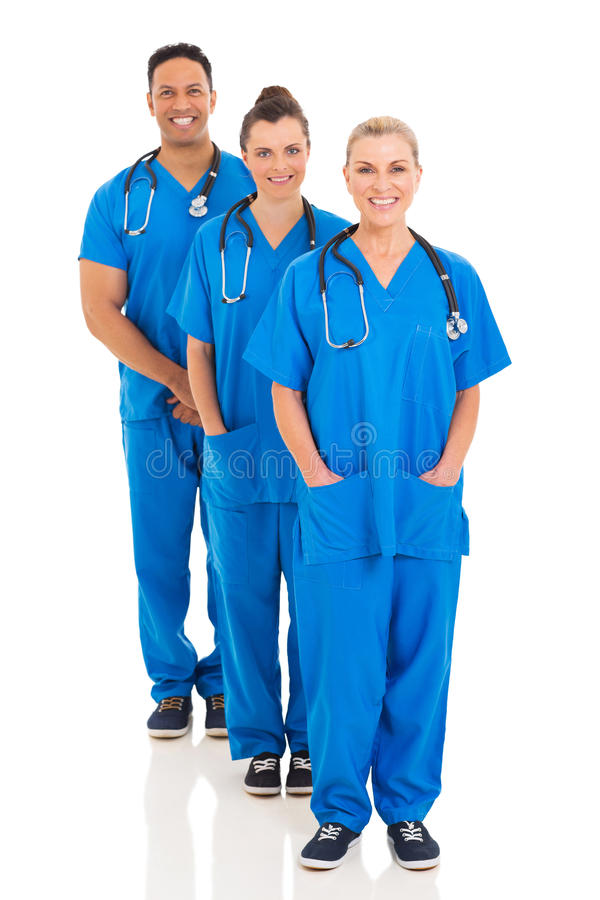 Group medical team. Group of professional medical team standing in a row on white background royalty free stock image