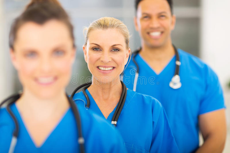 Group medical workers. Group of happy medical workers line up royalty free stock photo