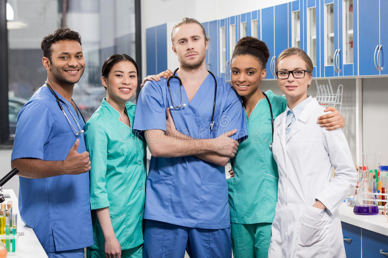 Group of medical workers in laboratory. Portrait of group of medical workers in laboratory royalty free stock images