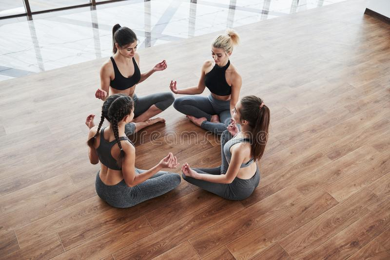 Group meditation. For girls creates a circle with their bodies and learning some exercises royalty free stock image