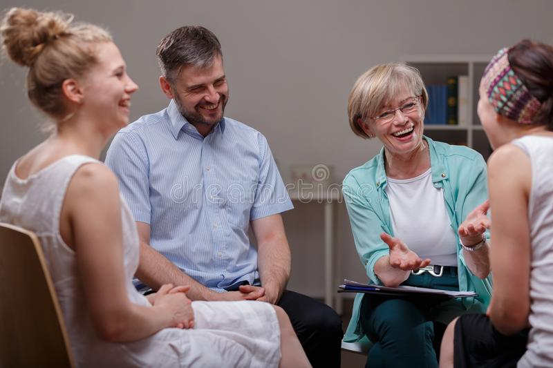 Group during meeting with therapist. Picture of support group during meeting with professional therapist stock photography