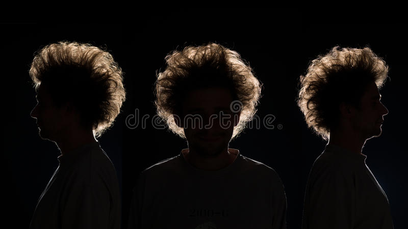Group of men in black shadow. Three man in black shadow on black background royalty free stock photography