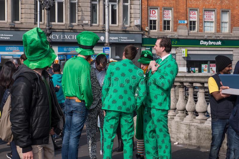 Group of men in green clothes and Irish hats on O`Connell Street in Dublin, Ireland on St. Patrick`s Day royalty free stock image