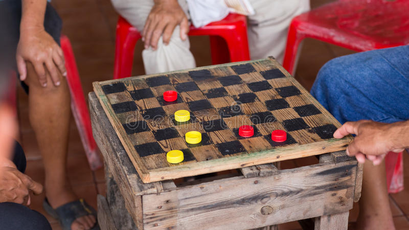 Group of men are having fun playing checker. Draught, game royalty free stock photos