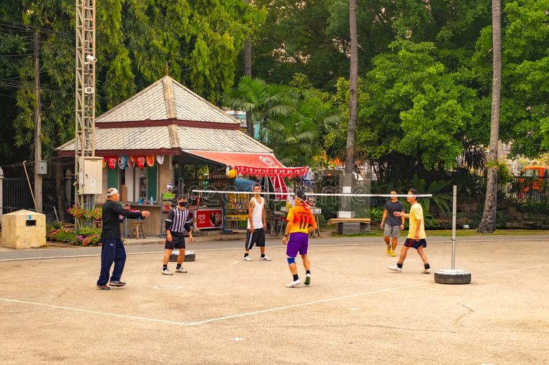 A group of men playing Sepak Takraw royalty free stock images