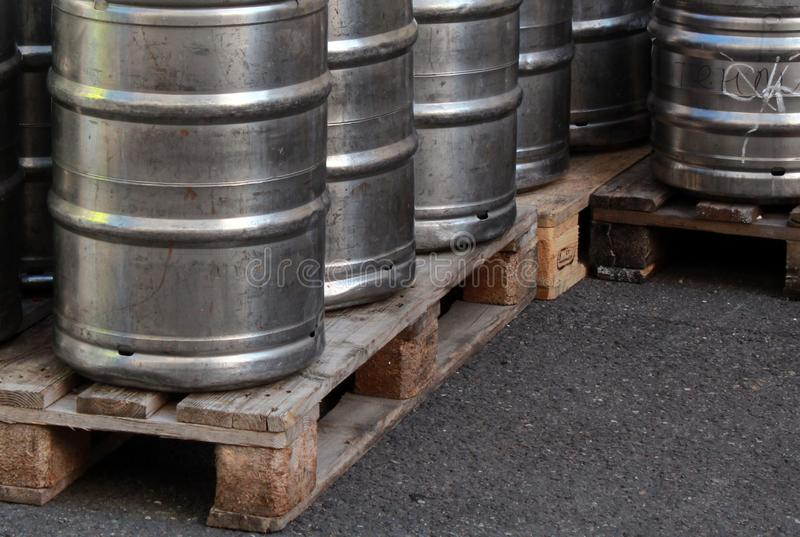 Group of beer kegs on the pallet. Group of the metall coloured beer kegs on the wooden pallet royalty free stock image