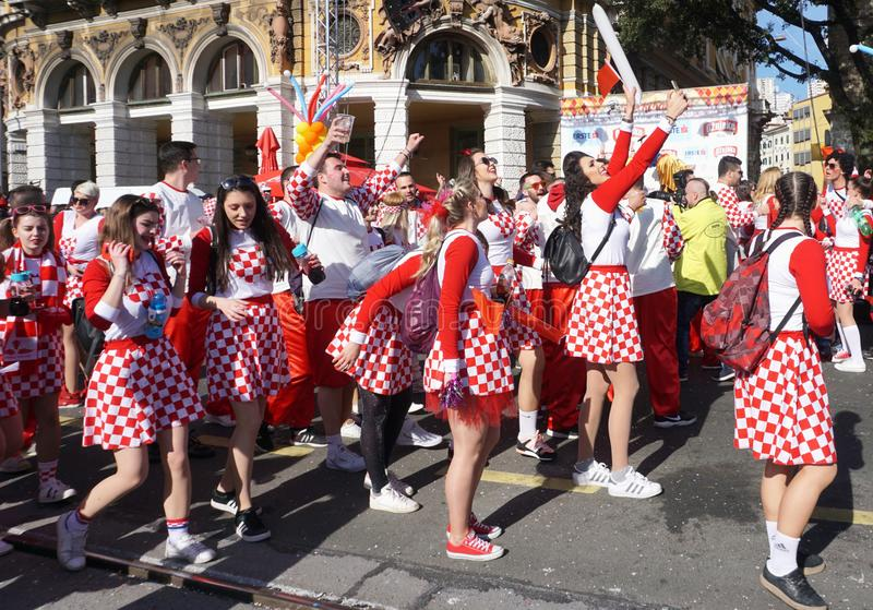 Group of Millennials dressed in costume with Croatian national pattern with red and white square dancing and celebrate on the royalty free stock photos
