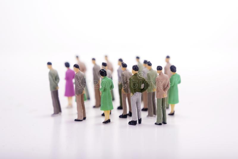 Group of miniature people over white background. royalty free stock photos