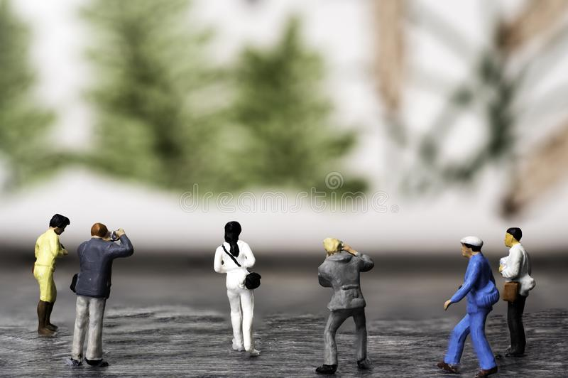 A Group of Miniature Photographers taking pictures of a Muriel stock photography
