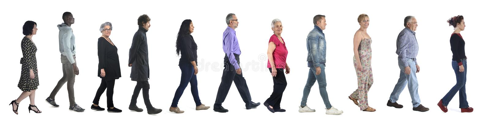 Group of mixed people walking on white royalty free stock image