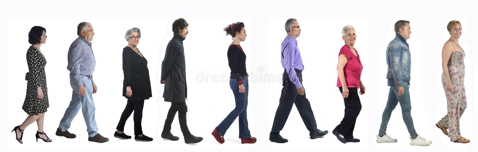 Group of mixed people walking on white stock photos