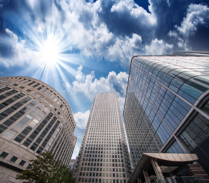Group of Modern Buildings in London Financial District, beautiful upward view at sunset stock image