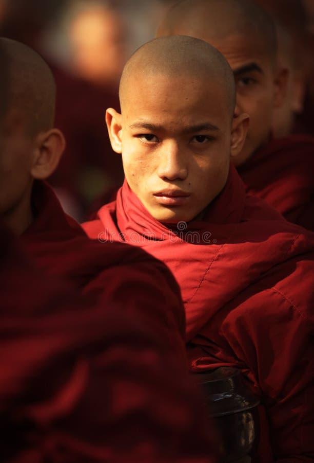 A group of monks in Amarapura, Myanmar (Burma). A group of Buddhist monks in a monastery in Amarapura, Myanmar (Burma royalty free stock images