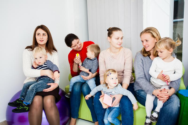 Group of mothers with kids royalty free stock image