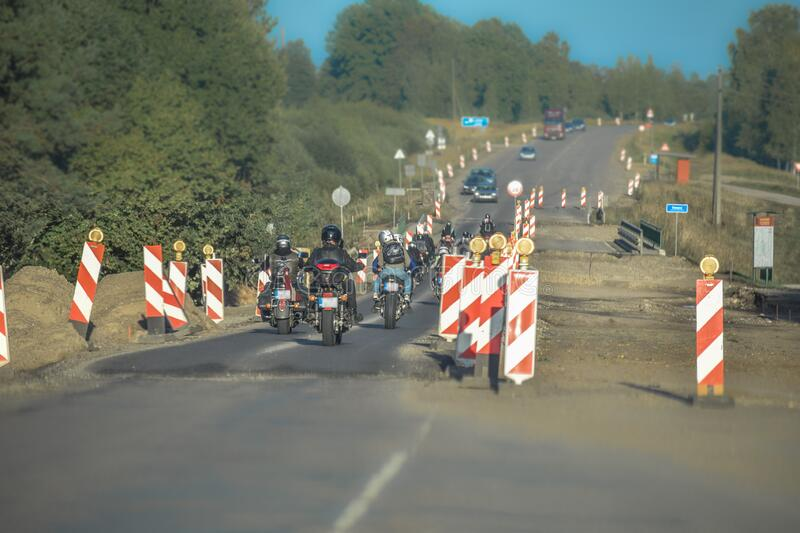 Group of motorcyclists driving over a under construction zone. In Latvia royalty free stock images